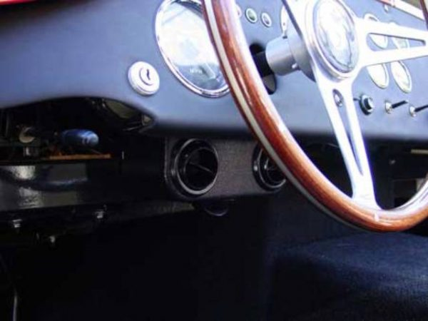 Vents hidden under the dash. Notice the bottom vent that blows air into the footbox.,  Air Conditioning